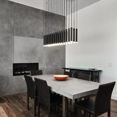 Multi-light chandelier in dining area with grey slate walls