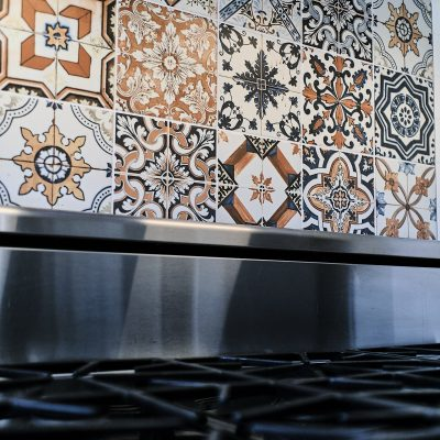 Fancy tiled backsplash in kitchen remodel